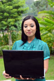 Portrait young pretty Asian muslim college girl with laptop and smile Royalty Free Stock Photos