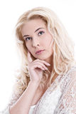 Portrait of  young pretty blond woman thinking on white backgrou Stock Image