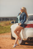 Portrait of a young pretty blonde with luxury car Stock Photo