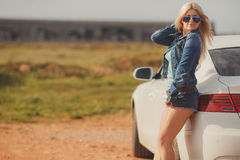 Portrait of a young pretty blonde with luxury car Stock Image