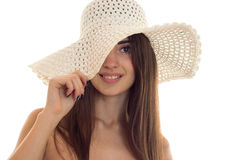 Portrait of young pretty brown hair woman in straw hat with wide brime looking and smiling on camera isolated on white Royalty Free Stock Photo