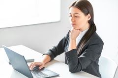 Portrait of young pretty business woman with laptop. In the office Stock Images