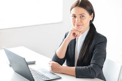 Portrait of young pretty business woman with laptop. In the office Stock Photo