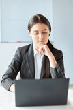 Portrait of young pretty business woman with laptop Stock Photography