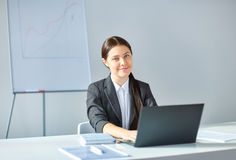 Portrait of young pretty business woman with laptop Royalty Free Stock Photo