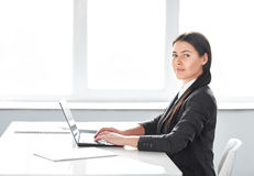 Portrait of young pretty business woman with laptop Stock Photo