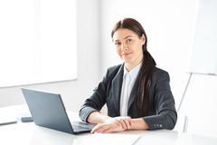 Portrait of young pretty business woman with laptop Royalty Free Stock Photos