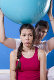 Portrait of a young pretty couple, fitness indoor, exercise ball Stock Image
