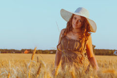 Portrait of young pretty girl dressed in bright hat Stock Photos