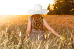 Portrait of young pretty girl dressed in bright hat Stock Images