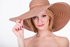Portrait of young pretty girl in elegant hat Stock Photography