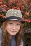 Portrait of a young pretty girl in hat in the fall outdoors. Nature. Royalty Free Stock Images