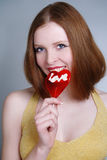 Portrait of young pretty girl holding a lollipop Stock Images