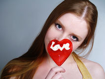 Portrait of young pretty girl holding a lollipop Stock Image