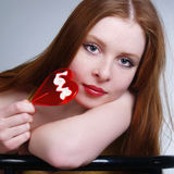 Portrait of young pretty girl holding a lollipop Royalty Free Stock Image