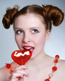 Portrait of young pretty girl holding a lollipop stock photos