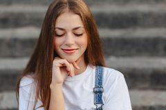 Portrait of young pretty girl sitting on stairs stock image