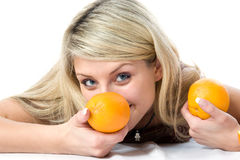 Portrait of young pretty girl with two orange Stock Photography