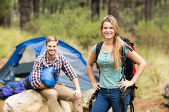 Portrait of a young pretty hiker couple holding a sleeping bag and backpack Stock Photography
