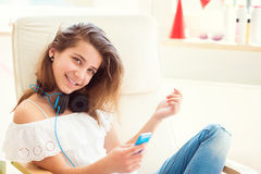 Portrait of young pretty teenage girl listening music with moder Royalty Free Stock Photos