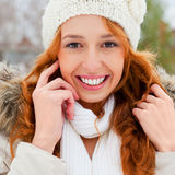 Portrait of young pretty woman. Portrait of beautiful young red hair woman outdoors in winter looking at camera and enjoying snow royalty free stock image