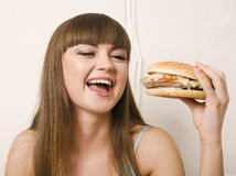 Portrait of young pretty woman with burger Stock Photo