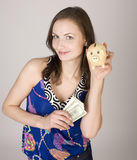 Portrait of young pretty woman with dollars Stock Photos