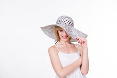 Portrait of young pretty woman in elegant hat smiling.  Stock Photos