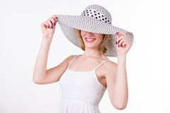 Portrait of young pretty woman in elegant hat smiling.  Stock Images