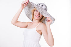 Portrait of young pretty woman in elegant hat smiling.  Royalty Free Stock Photos