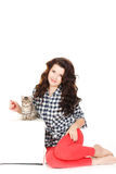 Portrait of a Young pretty woman holding her lovely little cat isolated on a white background Royalty Free Stock Photography