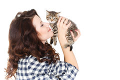 Portrait of a Young pretty woman holding her lovely little cat isolated on a white background Stock Image