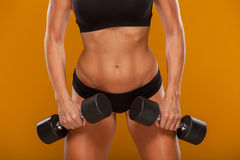 Portrait of a young pretty woman holding weights Royalty Free Stock Photo