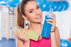 Portrait of a young pretty woman holding weights (dumbbell) and Stock Image