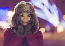 Portrait of young pretty woman outdoor in wintertime Royalty Free Stock Images