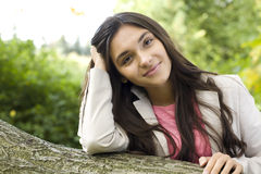 Portrait of young pretty woman in park Stock Photography