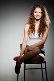 Portrait of young pretty woman sitting on chair Stock Photo