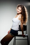Portrait of young pretty woman sitting on chair Stock Images