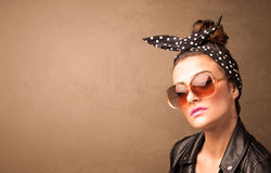 Portrait of a young pretty woman with sunglasses and copyspace Stock Photo