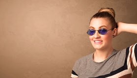 Portrait of a young pretty woman with sunglasses and copyspace Royalty Free Stock Photo