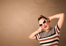 Portrait of a young pretty woman with sunglasses and copyspace Royalty Free Stock Image