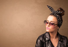 Portrait of a young pretty woman with sunglasses and copyspace Royalty Free Stock Photos