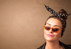 Portrait of a young pretty woman with sunglasses and copyspace Royalty Free Stock Images