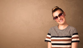 Portrait of a young pretty woman with sunglasses and copyspace Stock Image