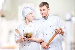 portrait of young professional chefs with a dish royalty free stock images