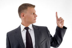 Portrait of young professional looking his finger Royalty Free Stock Images