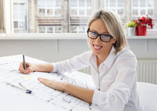 Portrait of young professional woman architect at work. Portrait of young professional woman architect at office Stock Photo