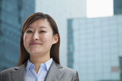 Portrait of young proud businesswoman outdoors among skyscrapers Stock Photo
