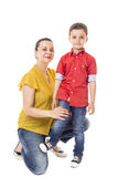 Portrait of a young proud mother with her adorable son Royalty Free Stock Photos