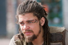 Portrait young rebel with dreadlocks and tattoos Royalty Free Stock Photos